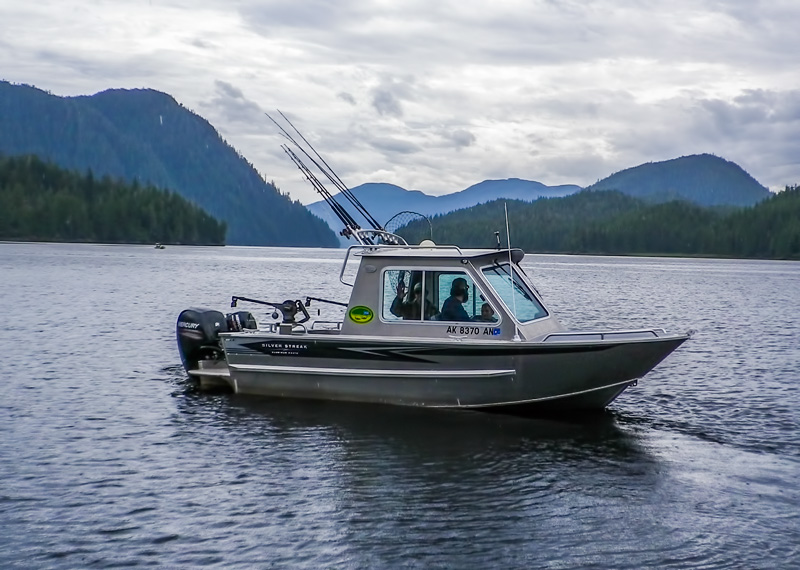 Fishing boat on middle of lake
